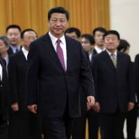 Scrutinized Chinese officials frozen in headlights of Xi's anti-graft campaign