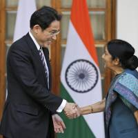 Japan to play more active security role, Kishida tells India