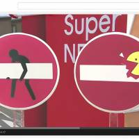 Woman held in Osaka for allegedly turning traffic signs into street art