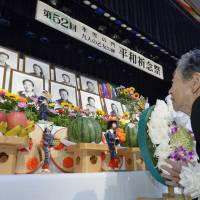 Mourners mark WWII Sakhalin post office suicides