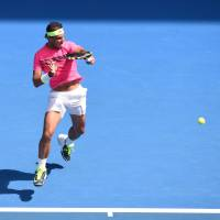 Nadal, Sharapova look sharp on way to quarterfinal berths