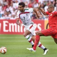 Iran sends Bahrain to opening defeat; UAE routs Qatar