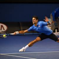 Determined Djokovic ousts defending champion Stan Wawrinka