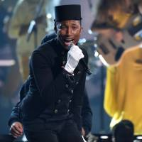 Smith, Pharrell lead Grammys, Perry spotlights domestic abuse