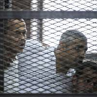 After more than 400 days, Egypt frees then deports Al-Jazeera reporter