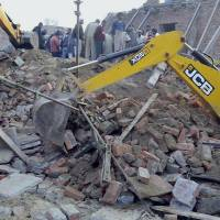 Building collapses, killing 13 people in north India