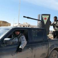 Syrian Kurds cut Islamic State supply line near Iraq; fears for Christians mount