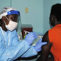 Liberia begins clinical trial for Ebola vaccines as outbreak ebbs