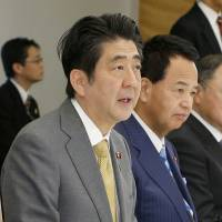 Japan adopts new aid policy, may aid foreign militaries