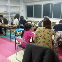 Foreign children getting help from local people in Osaka's Minami district