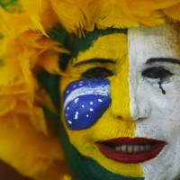 Hundreds of thousands march to demand Brazil president's ouster