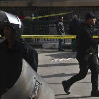 Bomb near top Cairo courthouse kills two; other blasts hit capital