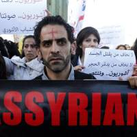 Islamic State group frees 19 Syrian Christians after ransom is paid: activists