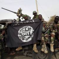 Boko Haram forces attack Nigeria's Gamboru, slaughter forced wives in Bama amid retreat