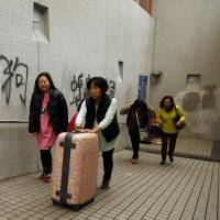 Chinese flee H.K. to shop in Japan and  South Korea