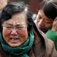 Chinese families mark MH370 anniversary under watchful eye of police