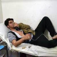 Monitor says Syrian army killed six in toxic gas attack; military denies it