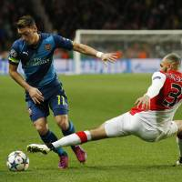 Monaco survives battering from Arsenal to reach quarters