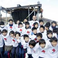 Murofushi, Miyagi Prefecture students team up to clean 1964 Olympic Cauldron