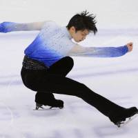 Reigning champion Hanyu triumphs in short program at worlds