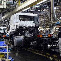 Despite signs of recovery, Japanese manufacturers resist Abe's call to spend