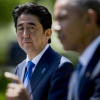 Chinese bank initiative, TPP potential keep Abe, Obama close