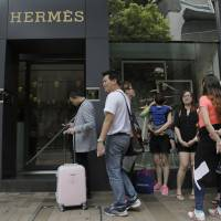 China limits visitor influx to Hong Kong, but residents warned against 'unruly' resistance to mainlanders