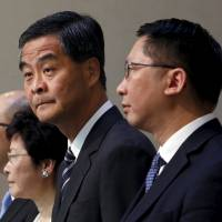Hong Kong toes China line with reform package, stoking talks of more protests