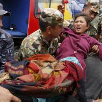 Aid slowly reaching remote villages in quake-hit Nepal; deaths top 5,000; aftershocks continue