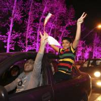 Joyful Iranians dance into night after nuclear breakthrough