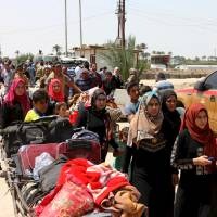 UN: 90,000 people have fled IS advance in Iraq's Anbar province