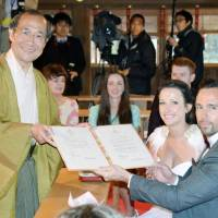 Kyoto issues souvenir marriage certificates to foreign newlyweds