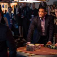 Will Smith gets under a waterfall of money in 'Focus'