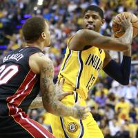 George returns to court as Pacers thump Heat