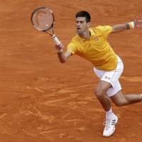 Djokovic wins in Monte Carlo to complete historic sweep