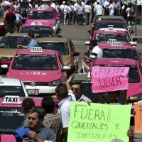 Mexico cabbies stage traffic-stopping protest targeting Uber