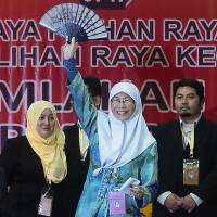 Jailed Malaysian opposition leader's wife wins his parliament seat