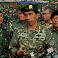 Indonesia's military re-enters civilian affairs after president crosses swords with police