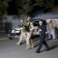 Gunmen storm guest house in Kabul, at least one American dead