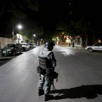 Police surround noted Kabul guesthouse after it's attacked; Taliban raids intensify