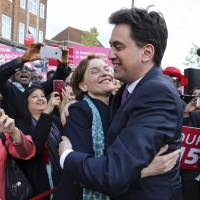 U.K.'s Labour poll challenger Miliband carves pledges in monument, gets lampooned