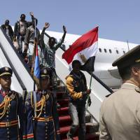 Sisi at Cairo airport greets Ethiopians 'rescued' from Libya