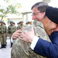 Turkish prime minister, with armored convoy, visits Ottoman tomb in Syria