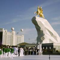 Turkmenistan unveils gold-covered statue of 'Protector' president riding a horse