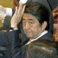 Abe says Constitution would rule out full-scale invasion, but 'exceptions' are unclear