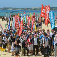 Okinawans march against U.S. bases on anniversary of sovereignty return
