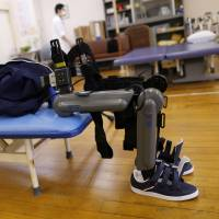 Exoskeleton that helps paralyzed walk faces bureaucratic barrier in Japan