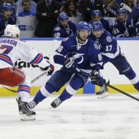 Lightning strike in OT to edge ahead over Rangers in series
