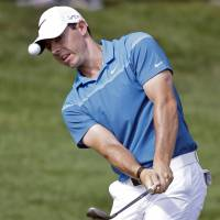 McIlroy shatters record in Wells Fargo victory