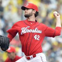 Carp pitcher Johnson putting it all together in Japan